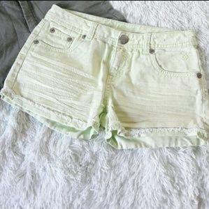 Justice bright light green shorts